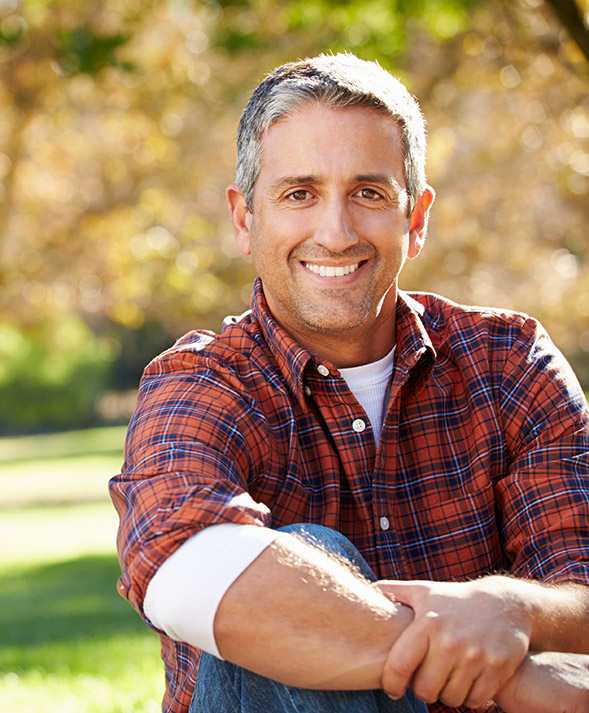 man in plaid smiling