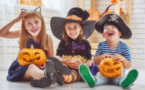 Children in costumes with candy.